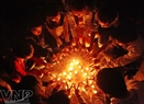 Young people shape candles into a five-wing star. Photo: Cong Dat