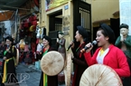 The performance's stage on the pavement in front of Dong Lac Communal House helps bring Quan ho closer to city dwellers.