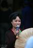 A female Quan Ho singer perform on Hang Dao Street in Hanoi Old Quarter.