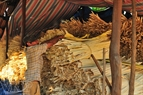 Dried Buong leaves are carefully covered before being sold.