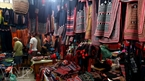 Colourful brocade products are sold at a market in Sapa.