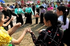 After the sacred rite, local people hold each other's hands to perform traditional songs and dances of Thai people.