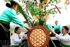 Decorating the Neu (Bamboo) tree, an important part of the ceremony where genies reside.