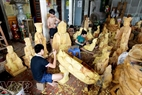 Each artisan takes responsibility for a part in the process of carving statues.