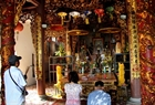 Visitors offer incenses to pray for peace in Nam Hai Than Vuong Temple on Hon Dau Island.