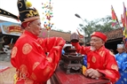 The solemn rite to worship Bo Cai Dai Vuong is performed by the village's elders at the communal house.
