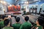 Young soldiers visit the exhibit hall in the Museum of National Defence Army Engineering.