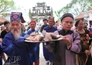 The tray of offerings is carried by the Hoang Family elders in the village.