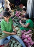 When the season of lotus comes, locals in Ho Tay are busy scenting tea with lotus flowers.