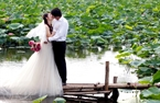 Taking wedding photos near a lotus pond.