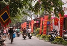 Hanoi streets are decorated with many posters. Photo: Thong Hai