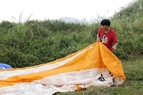 Checking parachutes before flying.