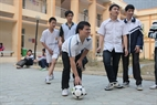 Children make an effort to overcome their troubles while playing football.