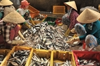 Women classify and clean fish before selling to merchants.