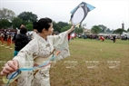 Junko Kitagawwa from Tokyo prepares to fly a Japanese traditional kite at the Imperial Citadel of Thang Long.