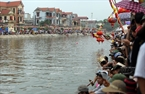 Tens of thousands of people throng the river banks.
