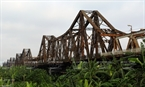 The Long Bien Bridge, the first steel bridge of its type crossing the Red River to connect the two districts of Hoan Kiem and Long Bien, was built from 1899-1902 by the French. Photo: Trinh Bo/VNP