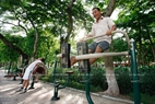 The pilot plan of installing exercise machines in public areas has improved its effectiveness in helping people to do exercises. Photo: Du Phien/VNP