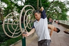 55-year-old Luong Thai Hung in Ngoc Lam does exercises with a shoulder abduction machine. Photo: Viet Cuong/VNP