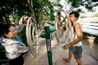 When asked, most people hoped to have more exercise machines in other areas in Hanoi. Photo: Du Phien/VNP