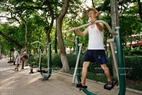 People excitedly practice with free exercise machines in Gia Lam Park. Photo: Viet Cuong/VNP