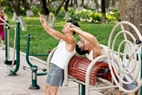 About 30 exercise machines are in Gia Lam Park, meeting the exercising demand of people. Photo: Du Phien/VNP