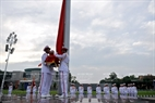 The flag raising ceremony is held in Ba Dinh Square.