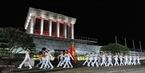 Soldiers process the national flag across President Ho Chi Minh's Mausoleum and end the ceremony.