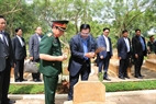 Prime Minister Hun Sen visits the relic site of Division 125 in Long Giao commune, Cam My district, Dong Nai province. In the photo:  Prime Minister Hun Sen and Vietnamese Defence Minister Ngo Xuan Lich offer incense to Cambodian martyrs at the cemetery in the relic site. Photo: Sy Tuyen/VNA