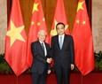 El secretario general del PCV Nguyen Phu Trong  se reúne con el primer ministro de China, Li Keqiang. Foto: Tri Dung – VNA