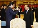 Премьер-министр Вьетнама Нгуен Суан Фук устроил торжественный прием в честь премьер-министра Японии Синдзо Абэ. Фото: Тхонг Нят - ВИА