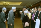 Emperor Akihito and Empress Michiko have a meeting with Japanese veterans' families living in Vietnam. Photo: Nguyen Dan/VNA