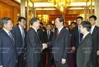 중국을 방문중인 잔다이꽝(Trần Đại Quang)국가주석이 12일오전 베트남-중국 경제무역협력 좌담회에 참석하여 발표하고있다. 사진:난상(Nhan Sáng)/베트남 통신사