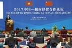 잔다이꽝(Trần Đại Quang)국가주석이 12일오전 베트남-중국 경제무역협력 좌담회에 참석하여 발표하고있다. 사진:난상(Nhan Sáng)/베트남 통신사