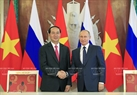 President Tran Dai Quang and President Putin witness the signing ceremony of cooperation agreements between the two countries. Photo: Nhan Sang / VNA