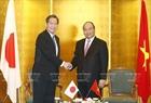 6月5日上午在首都东京,政府总理阮春福会见马自达汽车公司执行官Yuji Nakamine。越通社记者统一摄