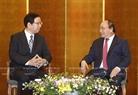 6月6日下午在首都东京,政府总理阮春福会见日本共产党委员长志位和夫。越通社记者统一摄