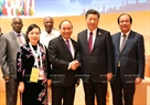 Prime Minister Nguyen Xuan Phuc met with President of the People's Republic of China Xi Jinping in Hamburg on July 8 on the sidelines of the G20 Summit. Photo: Thong Nhat / VNA