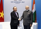 In another meeting with his Indian counterpart, Narendra Modi, the Vietnamese PM urged India to gradually clear trade barriers towards lifting two-way trade to 15 billion US dollars by 2020.  Photo: Thong Nhat / VNA
