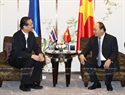 Prime Minister Nguyen Xuan Phuc receives Chief Executive Officer of Amata Corporation PCL Vikrom Kromadit in Bangkok on August 18. Photo: Thong Nhat/VNA