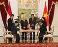 Tổng Bí thư Nguyễn Phú Trọng và Tổng thống Indonesia Joko Widodo chứng kiến Lễ ký Bản ghi nhớ về hợp tác phát triển thông tin giữa Bộ Nông nghiệp và Phát triển nông thôn Việt Nam với Bộ Phát triển Làng xã các vùng khó khăn và Nhập cư Indonesia. Ảnh: Trí Dũng/TTXVN