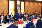Во второй половине дня 9 октября 2018 года в столице Токио Премьер-министр Вьетнама провел беседу с представителями ведущих японских предприятий недвижимости, организованную Министерством планирования и инвестиций Вьетнама совместно с ассоциацией недвижимости в городе Хошимин и корпорацией Бентхань. Фото: Тхонг Нят/ВИА