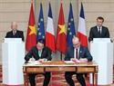 The signing ceremony of a memorandum of understanding (MoU) between the Vietnamese Ministry of Natural Resources and Environment and the French Development Agency (AFD). Photo: Tri Dung / VNA