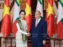 Prime Minister Nguyen Xuan Phuc and Myanmar State Counsellor, Minister of Foreign Affairs and Minister of the President's Office Aung San Suu Kyi before their talks in Hanoi on April 19. Photo: Thong Nhat/VNA