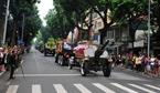 The hearse carrying the coffin of President Tran Dai Quang crosses Tran Thanh Tong street, Hoan Kiem district, Hanoi. Photo: Nguyen Khang/VNA