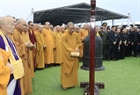 The monks perform a ritual at the burial site. Photo: VNA