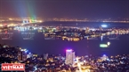 Panoramic view of West Lake and Nhat Tan Bridge in the distance sparkling at night. Photo: Cong Dat/VNP