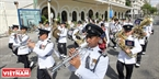 The police band from Singapore performs on Ton Duc Thang Road .