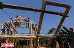 During the construction of a new stilt house, the most important stage is setting up the tortoise-shaped roof. Photo: Thong Thien