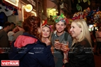 Foreign visitors enjoy beer to celebrate the New Year. Photo: Thong Thien